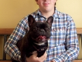 A client with a French Bulldog sitting in the waiting area