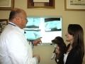 Dr. Corradini explaining an x-ray to a client