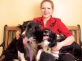 A client with 2 Border Collies sitting in the Waiting area