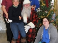 Santa poses with Dr. Corradini and staff