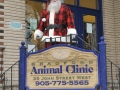 Santa stands on the front steps of The Bradford Animal Clinic