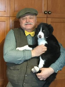 Dr. Corradini holds a Border Collie puppy